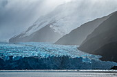 View of the right side of the glacier, captured in a short flurry of snow, Garibaldi Glacier, near Beagle Canal, Alberto de Agostini National Park, Magallanes y de la Antartica Chilena, Patagonia, Chile, South America