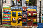 A charming miniature living scene in one of the city's many narrow streets, Valparaiso, Valparaiso, Chile, South America