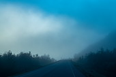 Eerie view of a foggy mountain road, near Puerto Chacabuco, Aysén, Patagonia, Chile, South America