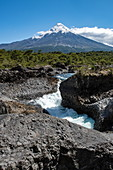 The famous Petrohue cascades with the snow-capped Osorno volcano in the distance, near Puerto Montt, Los Lagos, Patagonia, Chile, South America