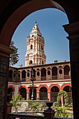 View of a nearby tower through an archway in the courtyard of the 16th century Casa Aliga, Lima, Lima, Peru, South America