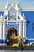 The ornate blue and white entrance to the colonial Banco Central on the Plaza de Armas in Trujillo, La Libertad, Peru, South America