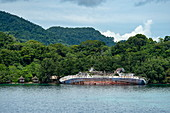 The wreck of the expedition ship World Discoverer has been lying on the edge of the jungle in Roderick Dhu Bay, Honiara, Roderick Bay, Nggela Islands, Solomon Islands, South Pacific since its stranding on April 30, 2000