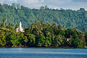 A lonely church stands on a crest surrounded by lush vegetation over the water, Garove Island, Vitu Islands, West New Britain Province, Papua New Guinea, South Pacific