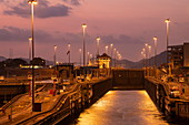 Early evening view of the approach to the Miraflores Locks in the Panama Canal, near Panama City, Panama, Central America