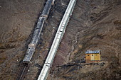 Coal transport systems on the side of a steep mountain outside the former mining town of Pyramiden, Billefjord, Spitsbergen, Norway, Europe