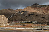 View of dilapidated buildings and decaying infrastructure in the former coal mining town of Pyramiden, Billefjord, Spitsbergen, Norway, Europe