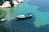 Small fishing boat in front of the capital of Skiathos island, Greece