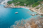 View of a boat on Kastro beach on Skiathos island, Greece