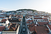Morning view from the observation deck of the Elevador da Santa Justa over the rooftops of Lisbon, Portugal