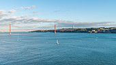 View of the Tagus, the Ponte 25 de April and the Christ statue, Lisbon, Portugal