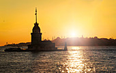 Sunset overlooking the Maiden's Tower and the city's many mosques, Istanbul, Turkey