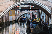 The typical Venetian gondolas in the city canals, Venice, Italy