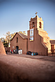 Participants of a parade dress in front of Iglesia (Church) San Pedro de Atacama, Atacama Desert, Antofagasta Region, Chile, South America