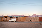 simple apartment buildings in San Pedro de Atacama, view to the Licancabur volcano in the Cordillera Occidental, Atacama Desert, Antofagasta Region, Chile, South America