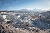 Minerals mining, in the background Licancabur volcano in the Cordillera Occidental, San Pedro de Atacama, Atacama Desert, Antofagasta Region, Chile, South America