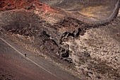 Detail of a person running on the volcanic landscape of the Osorno, Region de los Lagos, Chile, South America