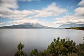 View of the cloud-covered Osorno volcano, Llanquihue Lake, Region de los Lagos, Chile, South America