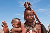 Himba woman with baby, Damaraland, Namibia