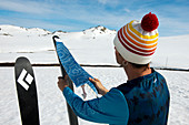 Putting on the skins in the Kosciuszko National Park, multi-day ski tour, NSW, Australia
