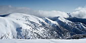 View from Mt. Hotham ski area to the snow-covered Mt. Feathertop and the Razorback Ridge, Victoria, Australia