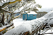 The Derrick Lodge in the Alpine National Park after a cold snap in spring, Victoria, Australia