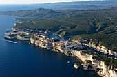 France, Corse du Sud, Bonifacio, the limestone cliffs, the citadel and the old town, the rock called Grain de Sable in the foreground (aerial view)