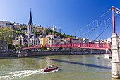 France, Rhone, Lyon, historical site listed as World Heritage by UNESCO, footbridge and St Georges Church over Saone River and Notre Dame de Fourviere Basilica