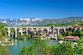 France, Drome, Saint-Nazaire-en-Royans, the aqueduct built in 1876, 35 meters high and 235 meters long, is converted into pedestrian path, Vercors massif in the background