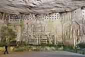 France, Dordogne, Brantome, Saint Pierre benedictine abbey, remains of the first monastery built in the foot of the cliff the cave including the Last Judgement, right Crucifixion from the early 17th century, left bas relief of the fifteenth century under the pigeonholes