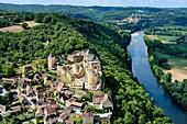 France, Dordogne, Perigord Noir, Dordogne Valley, Castelnaud la Chapelle, labelled Les Plus Beaux Villages de France (The Most Beautiful Villages of France), Castelnaud Castle on a cliff above the Dordogne valley (aerial view)