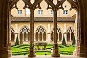 France, Dordogne, Perigord Noir, Le Buisson de Cadouin, the cloister of the former Cistercian abbey in flamboyant gothic style located on the Chemin de Saint Jacques de Compostelle listed as World Heritage by UNESCO
