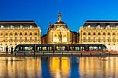 France, Gironde, Bordeaux, area listed as World Heritage by UNESCO, Saint Pierre district, Place de la Bourse, the reflecting pool from 2006 and directed by Jean-Max Llorca hydrant, football game