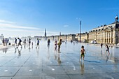 France, Gironde, Bordeaux, area listed as World Heritage by UNESCO, 18th century Bourse square, The Miroir d'eau (Water Mirror), 2006 work by the fountain maker Jean-Max Llorca, architect Pierre Gangnet and urbanist Michel Corajoud