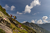 Female hikers climb to the Bochette de la Froda, Trekking del Laghetti Alpini, Ticino, Switzerland