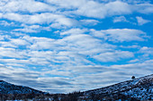 Snowy hills under cloud