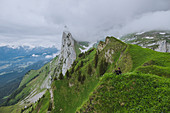 Woman sitting on mountain in Appenzell, Switzerland