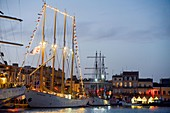 France, Herault, Sete, Escale a Sete Festival, Portuguese four-masted schooner Santa Maria Manuela in a harbor at dusk