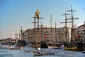 France, Herault, Sete, Escale a Sete Festival, traditional games on a channel with tall ships background