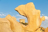 France, Corse du Sud, Belvedere Campomoro, taffonis or rocks sculptured by the erosion in front of the Genoese tower of Campomoro