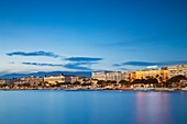 France, Alpes-Maritimes, Cannes, the Croisette and its palaces Carlton and Martinez at twilight