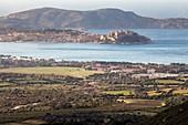 France, Haute Corse, Balagne, forward plan the military camp Raffalli, the citadel of Calvi, in background the peninsula of Revellata