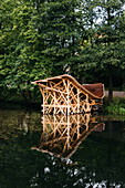 A wooden art installation on a village pond, Fiskars, Finland