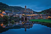 France, Aveyron, Estaing, bridge isted as World Heritage by UNESCO, listed as The most beautiful villages in France, town and its bridge reflecting in the river Lot