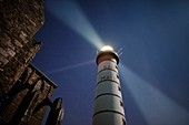 France, Finistere, Plougonvelin, Saint Mathieu point, The Saint Mathieu lighthouse rays in the night, listed as Historical Monument