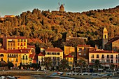 France, Pyrenees Orientales, Collioure, beach and windmill at sunset
