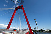 Red pylon and rope ties of the Willemsbrücke, Rotterdam, Holland