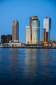 View of the skyline at the cruise terminal in Rotterdam, Netherlands during the blue hour over the New Maas.