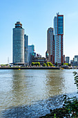 View over the New Meuse to the new district of Kop van Zuid. With the buildings World Port Center, Hotel New York and the Montevideo Tower. Rotterdam, The Netherlands, June 2020