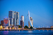 View over the New Meuse towards the illuminated Zuid and Kop van Zuid districts during the blue hour, Rotterdam, Netherlands, June 2020